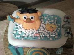 Homemade Rubber Duckie Cake: This is a Rubber Duckie Cake I made for a friend. Its Ernie and his Rubber Duckie taking a tubby. The tub is the cake carved and covered in fondant with