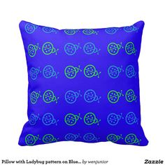Pillow with Ladybug pattern on Blue Background