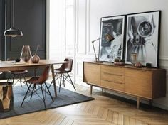 Mid century console. Black and white oversized photography. Herringbone floor. Modern table and chairs.
