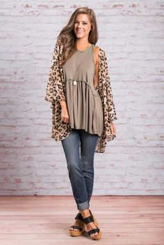You should definitely add a little feline charm to your wardrobe! This kimono should do just the trick! It's sheer fabric is so flowing and the cut is beautifully loose. This kimono will look so fab over so many different tops and dresses! You will be feeling you feline inspired outfit in no time!