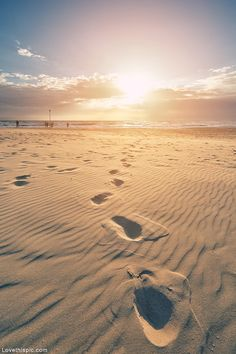 Sandy footprints summer beach ocean sun sand