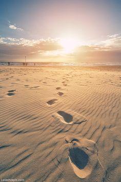Sandy footprints summer beach ocean sun sand