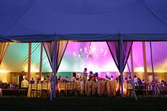 The party continues and this tent is lit with exciting colors for dancing and celebrating! | A Day In May, Event Planning & Design | Northern Michigan Weddings | Traverse City Weddings | Spring Splendor at the Ranch | Snow Moon Ranch, Maple City | Dan Stewart Photography