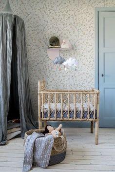 lovely floral wallpaper and wicker crib in this bohemian girls nursery Blomstermåla │ Johanna Bradford