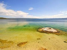 Yellowstone Lake, Wyoming  Crystal clear water with geysers and —Yellowstone Lake is definitely a beauty to behold. The lake's proximity to Yellowstone's colorful hot springs (some of which are actually located in the lake itself) make it a popular spot for both kayakers and leisurely walkers.