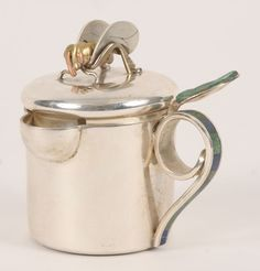 """Los Castillo Taxco Mexican mixed metals honey pot. Inlaid stone handle and foliate thumb rest, the lid with bee form lift with copper accents. Marked """"Los Castillo, Taxco, Hecho a Mano Mexico, 151"""" on the base. 3 1/2""""H."""