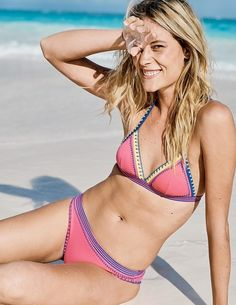 This colourful halterneck bikini top, with embroidered trims, features a fixed clasp on the back so it's easy to put on, and ties around the neck to adjust the fit. It doesn't skimp on support, either – the underband holds everything in place, while lightly padded cups keep your shape smooth.