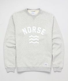 A superb crew neck sweat from the Norse Projects Spring 12 Pre-Collection. Features a water-based front logo, sporty rib inserts on the front and back below the neckline, a white Norse Projects tab which sits just above the hem and a brushed cotton inner. Runs small - we would recommend sizing up.