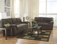 """With a soft textured upholstery fabric surrounding the plush comfort of the padded arms and supportive divided back design, the """"Zyler-Coffee"""" upholstery collection beautifully combines rich contemporary style with relaxing quality to create the perfect upholstery group for any living room décor."""