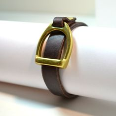 LEXINGTON Thin Leather Strap Bracelet with Brass Equestrian Horse Detail Stirrup. $19.95, via Etsy.