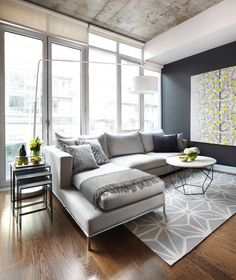 Grey and Yellow Living Room Design with modern sectional - I really like how they incorporated the throw blanket