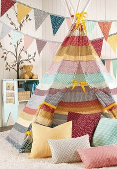 How cool is this DIY Striped Fabric Teepee for the kids'€™ room? Such an easy tutorial. Find it right here! | shop supplies @joannstores