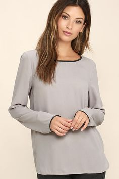The office, happy hour, and that special weekend event are all perfect occasions for the Get the Look Grey Long Sleeve Top! Lightweight woven poly shapes this versatile blouse with a bateau neckline, long sleeves, and black vegan leather trim. Relaxed bodice has a cutout back and notched hem.