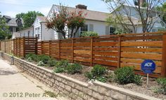 A Santa Monica fence builder's photo of a custom horizontal style contemporary wood fence. See over photos of my fine wood fences, gates and more. Serving the Santa Monica and Los Angeles area and building beautiful, custom wooden fences.