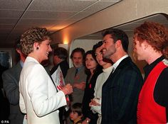 Princes Diana talks to George Michael (second right) ahead of a concert of Hope at Wembley...