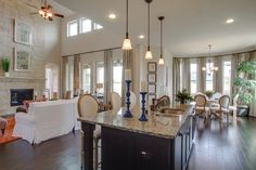 Open concept/Family Room + Kitchen + Breakfast area. Love the mixture of blue, green, orange and white!  Firethorne - Houston Real Estate http://www.coventryhomes.com/houston/firethorne/communities