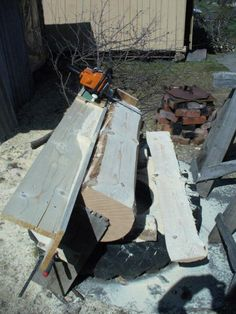 Home built chainsaw mill. This setup looks easier to handle than the typical Alaskan mill design. This provides full support for the weight of the saw, for one. Russian text, but worth it just for the photos