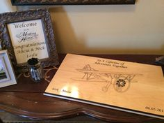 a wooden airplane adventure sign as a guestbook for our aeronautical engineering couple #guestbook #wedding