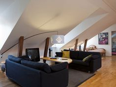 Amazing Attic of a House Ideas: Charming Attic Of A House Ideas With Black Sofas Combine With Wooden Table Also Black Tv And Unique Standing Lamp ~ youahh.com Attic Design Inspiration