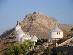 Leros Castle and wind mills _ Leros Island, Greece Greek Beauty, Virtual Travel, Greece Islands, Medieval Town, Le Moulin, Greece Travel, Science And Nature, Holiday Destinations, Monument Valley
