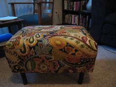 I actually made this! Fabric from Hobby Lobby and ottoman from the Salvation Army.