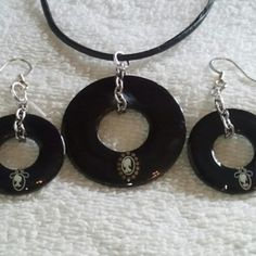 @KyDanJenjewelry Black #wearableindustrialart necklace & earring set with cameos. Hand painted. Length is 18in on leather cord with spring ring clasp. from KyDanJenjewelry for $25.00 on Square Market