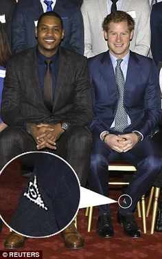 The Prince was revealed to be wearing bargain golf socks when he sat down for an official photo at the event