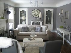The Grey room, a formal living room, A calm and peaceful room, created with a neutral grey palette, soft fabrics, and romantic decor. This room was furnished and decorated almost entirely with second-hand goods!, Plush furniture is arranged so it is conducive to conversation and still focuses on the beautiful fireplace. , Living Rooms Design