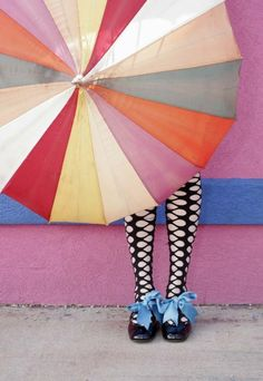 Carnival umbrella and blue ribbon shoes.  Photographer Unknown.