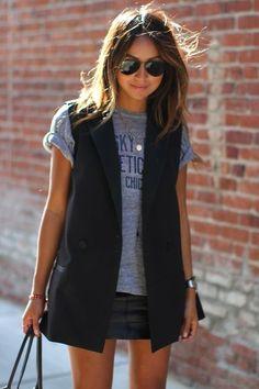Casual black sleeveless blazer look.