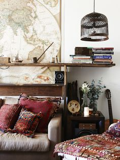 Love this big map, Bohemian style and the cage light.