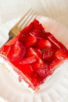 Strawberry Pretzel Salad - A taste of nostalgia! This dessert has a pretzel crust, cream cheese filling, & fresh strawberries in Jello on top. A summer classic!