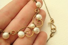 Antiqued brass scroll necklace with white freshwater button pearls - wire wrapped delicate spiral design - nice: