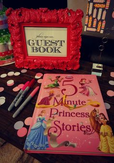 Baby girl baby shower guest book!  Buy a story book and have guests sign the front pages.
