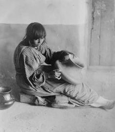 Here we present an historic image of a potter from Santa Clara Pueblo in New Mexico. It was taken in 1905 by Edward S. The image shows a Santa Clara Pueblo woman in a full-length portrait, seated with