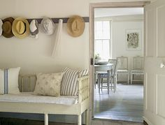 White painted wood bench with pillows, entrance