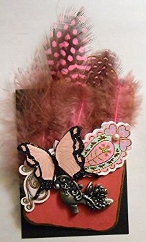 ATC-Feathers and Lace Black cardstock background, pink cardstock pocket, pink and black feathers, pink and black butterfly, charm shoe, white pearl.