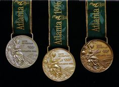 Close-ups of Olympic medals - This is a set of the 1996 Olympic gold, silver, and bronze medals, seen Wednesday, June 12, 1996, in Taunton, Mass., at the Reed & Barton factory. Reed & Barton produced 1,838 medals for the Centennial Olympic gamesin Atlanta. (AP Photo/Susan Walsh).