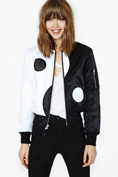 Insanely cool puffy two-tone bomber jacket featuring a yin yang print and zip pockets at sleeves. Zip closure, fully lined. Ribbed at collar...