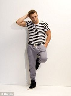 28 year old Australian actor and former model Jai Courtney ditches his  suit  for a T-shirt and trainers
