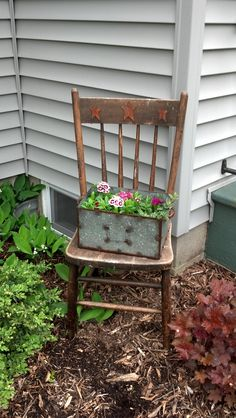 Old chair with flower box. This would perfect for the chair I have that my aunt gave me. It really can't be restored, so this is a perfect solution!