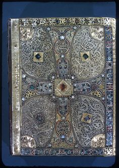 """Back cover - Early medieval treasure bindings with a structure in precious metal, and often containing gems, carved ivory panels or metal reliefs, are perhaps better known today than leather bindings, but these were for books used in church services or as """"book-icons"""" rather than for use in libraries.Of treasure bindings from this period, only the lower cover of the Lindau Gospels"""