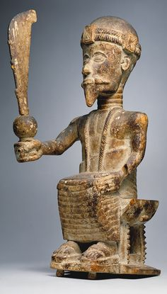 Seated Male Figure, 19th–20th century  Ghana; Akan  Wood, kaolin