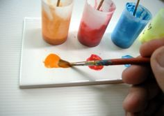 Polymer clay soaked in paint thinner turns into a product resembling paint. This can be used as a resist for collage. It can be painted onto paper, glass or a tile and baked, resulting in a flexible translucent sticker