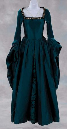 """Anne Boleyn"" costume green period dress and French hood from ""The Other Boleyn Girl"" (Columbia, 2008) - iridescent textured green dress w/ bright green/blue velvet lined sleeves, jeweled & beaded collar & French hood hat worn by Natalie Portman as ""Anne Boleyn"" in ""The Other Boleyn Girl"" film"