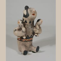 "#adobegallery Cochiti Pottery Storyteller Figurine with 2 Children. Damacia Cordero (1905-1989) Category: Figurines Origin: Cochiti Pueblo Medium: clay, pigment Size: 6-1/2"" tall Item # C3288C"