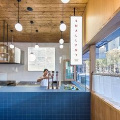 @sansarc.studio used blue terrazzo mottled grey travertine and stained wood to evoke a subtle seaside experience for diners at @smallfry_seafood an Adelaide chip shop with a Japanese twist. See more at dezeen.com/interiors #interiors #restaurants #adelaide #chipshop Photograph by @david_sievers_photography - Architecture and Home Decor - Bedroom - Bathroom - Kitchen And Living Room Interior Design Decorating Ideas - #architecture #design #interiordesign #homedesign #architect #architectural…