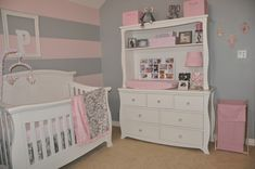 Pink n grey striped wall in nursery