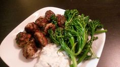 Turkey/chicken kale meatballs with baby broccoli.
