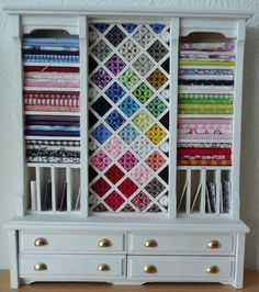 Love the idea of using furniture for storage.  Love the white.